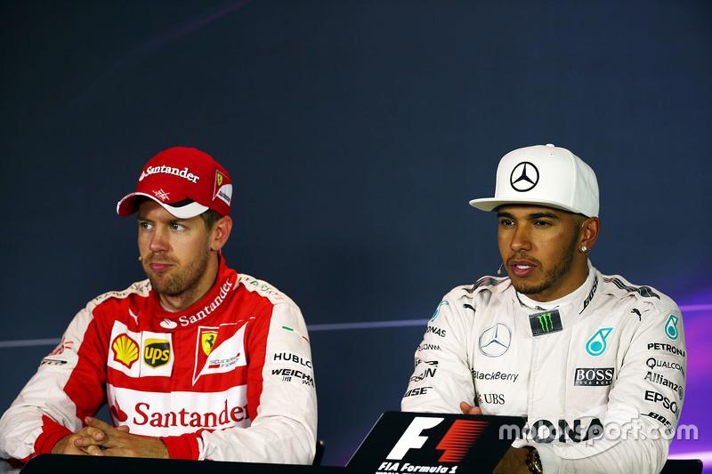 Sebastian Vettel, Ferrari with Lewis Hamilton, Mercedes AMG F1