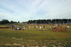 Fans enjoy the action on grassy hills