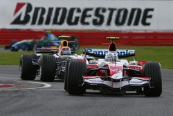 Jarno Trulli, Toyota Racing, TF107 and Mark Webber, Red Bull Racing, RB3