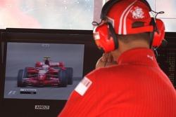 Michael Schumacher, Scuderia Ferrari, Advisor, watches Kimi Raikkonen, Scuderia Ferrari on the TV Monitors