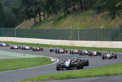 The pack streaming into the new Bus Stop chicane