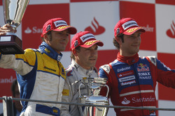 Timo Glock celebrates victory on the podium with Luca Filippi and Bruno Senna