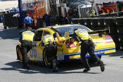 Sam Hornish Jr.'s crew gives him a push as he heads out to turn practice laps