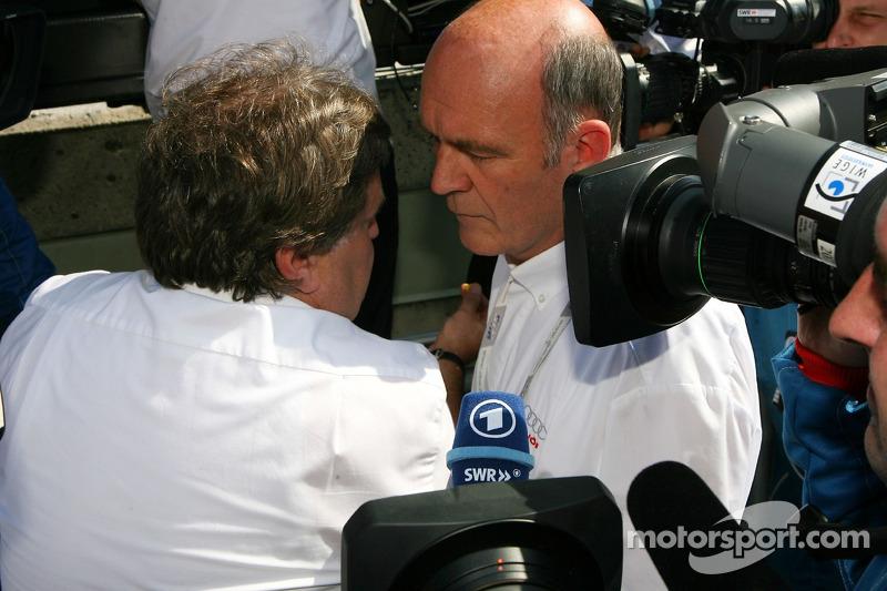 Вольфганг Ульрих, глава Audi Sport и Норберт Хауг, директор Mercedes-Benz Motorsport после того, как Audi сняала своих пилотов с гонки