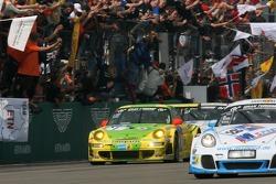 Race winner #1 Manthey Racing Porsche 911 GT3 RSR: Timo Bernhard, Marc Lieb, Romain Dumas, Marcel Tiemann celebrates