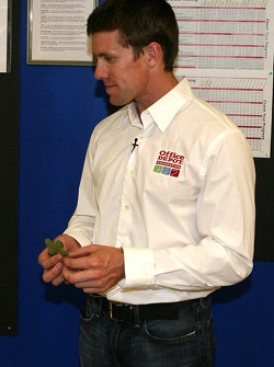 Carl Edwards with his four leave clover that was presented to him by Mitchell McGarry to put in his Office Depot Ford Fusion for the race at Kansas