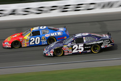 Denny Hamlin works his way around the slower car of Richard Johns