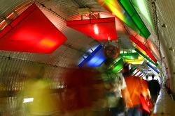 Race fans walk through the pedestrian tunnel