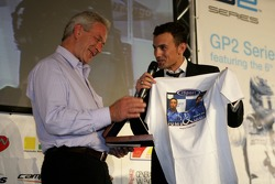 Will Buxton, presents Paul Jackson, iSport International Team Principal with a T-Shirt