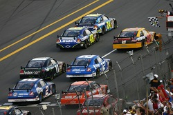 Jeff Gordon takes the checkered flag in front of Jimmie Johnson and Dave Blaney