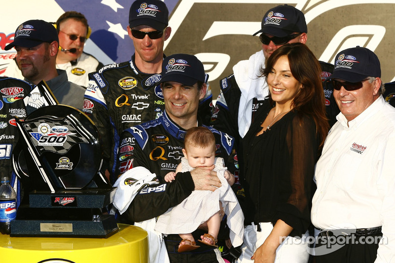 Victory lane: race winner Jeff Gordon celebrates with his baby girl Ella, wife Ingrid and Rick Hendrick