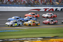 Jeff Gordon battles to the front in the tri-oval with two laps to go