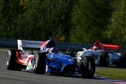 Buddy Rice, driver of A1 Team USA leads Satrio Hermanto, driver of A1 Team Indonesia