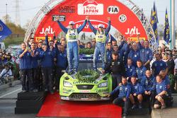 Podium: winners Mikko Hirvonen and Jarmo Lehtinen celebrates with BP Ford team members