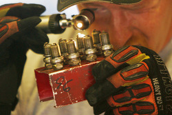 A crew member reads spark plugs out of Matt Kenseth's Ford