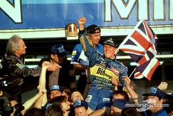 1995 Formula One World Champion Michael Schumacher celebrates with his team