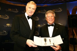 FIA President Max Mosley presents the prestigious FIA Gold Medal for Motor Sport to Mario Andretti