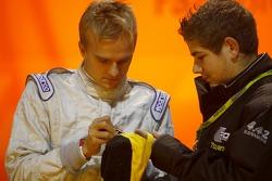 Heikki Kovalainen signs an autograph