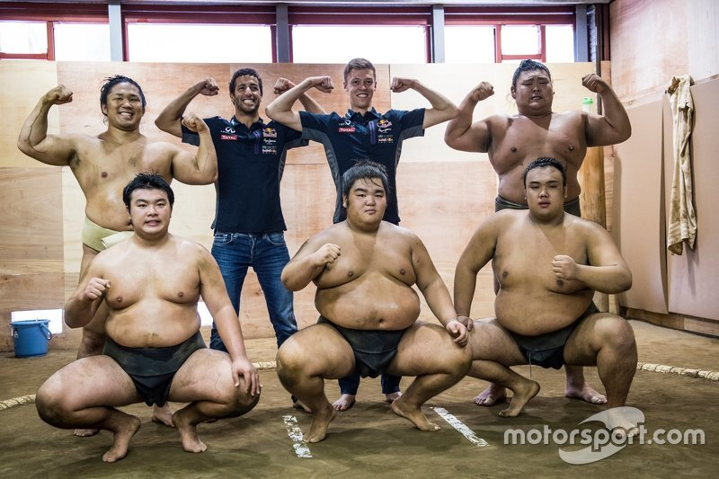 Daniel Ricciardo, Red Bull Racing and Daniil Kvyat, Red Bull Racing pose for a portrait with Sumo wrestler