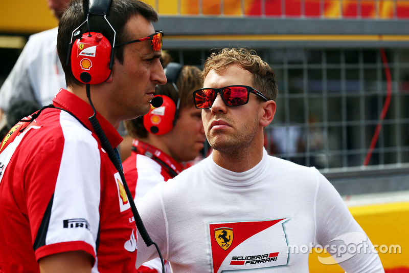 Sebastian Vettel, Ferrari with Riccardo Adami, Ferrari Race Engineer on the grid