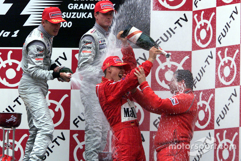 Podium: race winner and 2000 World Champion Michael Schumacher, Ferrari, second place Mika Hakkinen,