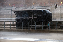 The Mercedes AMG F1 pit gantry takes a battering during a thunderstorm that cancelled FP3