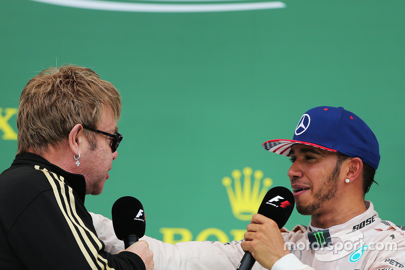 Podium: Sir Elton John with race winner and World Champion Lewis Hamilton, Mercedes AMG F1 on the po