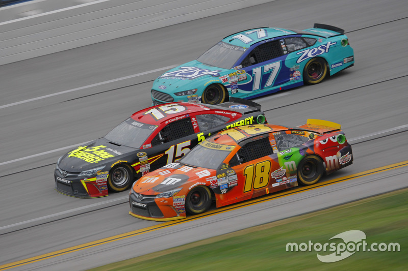 Kyle Busch, Joe Gibbs Racing Toyota and Clint Bower, Michael Waltrip Racing Toyota and Ricky Stenhouse Jr., Roush Fenway Racing Ford