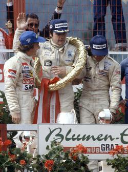 Podium: race winner Alan Jones, Williams, second place Gilles Villeneuve, Ferrari, third place Jacques Laffite, Ligier