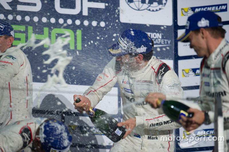 Race winners Timo Bernhard, Mark Webber, Brendon Hartley, Porsche Team celebrates on the podium