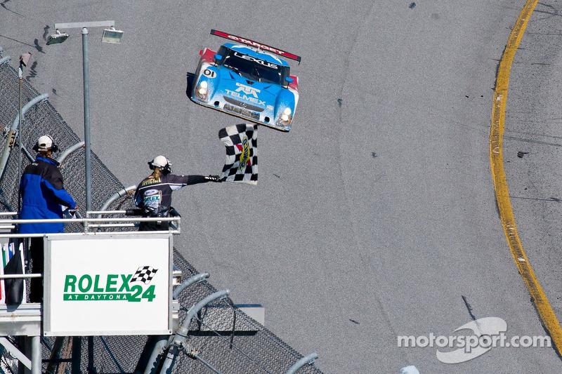 Overall winner Scott Pruett takes the checkered flag
