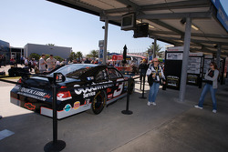 Fans pose with the commemorative car to celebrate the 10th anniversary of Dale Earnhardt's Daytona 500 win