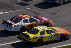 Tony Stewart and Clint Bowyer battle on pit road