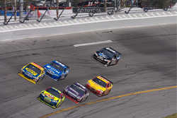 Casey Mears leads a group of cars in turn 4