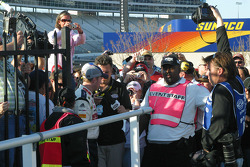 Dale Earnhardt Jr. works his way through the crowd to Victory Lane