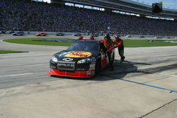 Martin Truex Jr.'s team push his expired car to the garage area