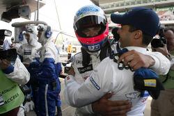 Pole winner Stéphane Sarrazin celebrates with Pedro Lamy