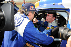 Rally winner Carlos Sainz and third place finisher Dieter Depping