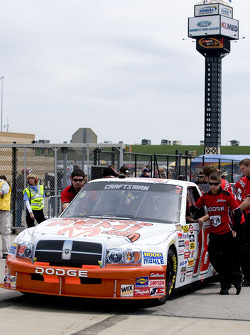 Crew members of the #18 Dennis Setzer push the truck onto the grid