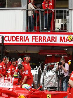 Michael Schumacher, Test Driver, Scuderia Ferrari watches over Felipe Massa, Scuderia Ferrari