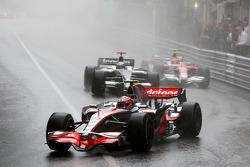 Heikki Kovalainen, McLaren Mercedes leads Nico Rosberg, WilliamsF1 Team