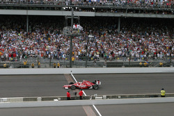 Race winner Scott Dixon takes the checkered flag
