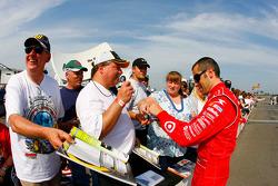 Dario Franchitti signs autographs
