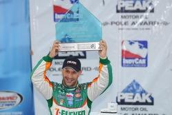 Pole winner Tony Kanaan raises his pole award