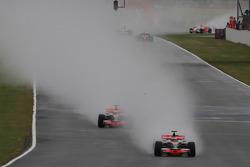 Start: Heikki Kovalainen, McLaren Mercedes, MP4-23 leads Lewis Hamilton, McLaren Mercedes, MP4-23