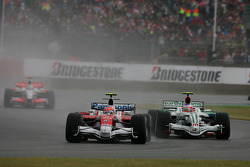 Timo Glock, Toyota F1 Team, TF108 leads Rubens Barrichello, Honda Racing F1 Team