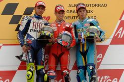 Podium: Sieger Casey Stoner, 2. Valentino Rossi, 3. Chris Vermeulen