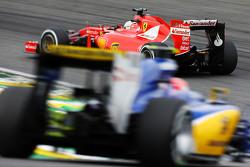 Sebastian Vettel, Ferrari SF15-T leads Felipe Nasr, Sauber C34