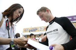 Maro Engel, Mercedes AMG Driving Academy signs autographs for the fans