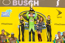 Victory lane: race winner and 2015 NASCAR Sprint Cup series champion Kyle Busch, Joe Gibbs Racing Toyota celebrates with wife Samantha and the Miss Sprint Cup girls